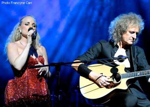 http://www.brianmay.com/brian/briannews/newspix/11/RAH_2414396877_Kerry_Red_Dress_and_Brian_by_Francyne_Carr_490.jpg